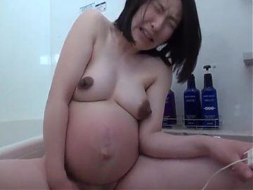 Pregnant Japanese woman with big nipples masturbates